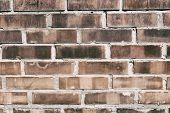 Fire Damaged Burnt Red Brick Wall Texture Background poster