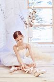 Little Prima Ballet. Young Ballerina Girl Is Preparing For A Ballet Performance. Girl In A White Bal poster