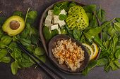 Vegan Lunch With Brown Rice, Avocado And Tofu On A Dark Background, Vegan Food Background. poster