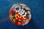 Colorful Pills And Medicines In Glass Plate On Blue Background. Different Pills And Another Drugs Ca poster