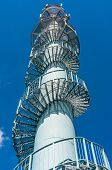 Telecommunications Tower On Blue Sky Background poster