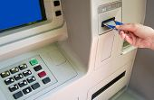 stock photo of automatic teller machine  - Woman accessing Automatic Teller Machine  - JPG