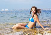 Attractive Girl In Swimwear At The Sea. poster