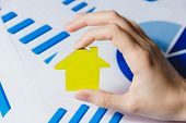 Female Hands Holding Yellow Paper House, Homeless Housing Shelter And Real Estate , Family House Ins poster