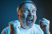 Screaming, Hate, Rage. Crying Emotional Angry Man Screaming In Colorful Bright Lights At Studio Back poster