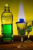 Bottle Of Absinthe And Glasses With Burning Cube Brown Sugar. poster