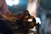 Selective Focus At Steel Cutter. Man Use Electric Steel Cutter And Clamp Metal In Factory And Throwi poster