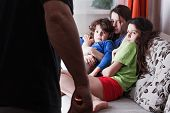 Drunk Father And Frightened Children Huddled From Fear Into A Corner. Domestic Violence, Abused Chil poster