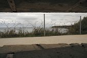 foto of emplacements  - Inside view from an old gun emplacement on the Nazi Atlantic wall over looking Omaha Beach - JPG