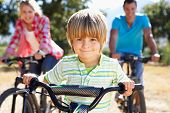 stock photo of bike path  - Young family on country bike ride - JPG