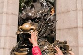 Buddhism Traveler And Hong Kong People Touching The Statue Of Brass Dragon To Bring Good Luck And Fo poster