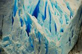 picture of crevasse  - Gorgeous blue ice stands out in vertical crevasses - JPG