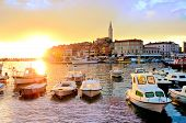 Old Town And Harbor With Boats And Vibrant Sunset Over The Sea, Rovinj, Croatia poster
