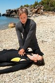 foto of cpr  - scuba diver rescue training carrying out CPR - JPG