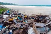 Pollution On The Beach Of Tropical Sea. Plastic Garbage, Foam, Wood And Dirty Waste On Beach In Summ poster