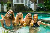 Beautiful Young Women In Swimwear Having Fun Together At Swimming Pool poster