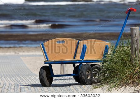 A Lonely Handcart Standing On The Way To The Beach