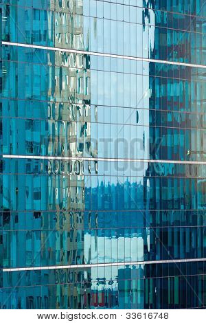 Reflections in modern glass-walled building facade