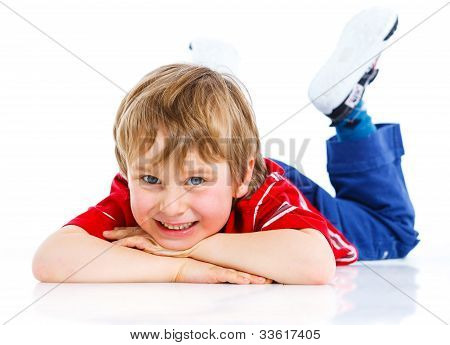Cute boy lying on floor