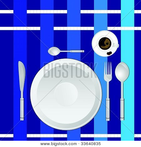 Dinner Service On A Blue Tablecloth