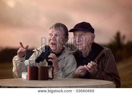 Curious Couple With Binoculars