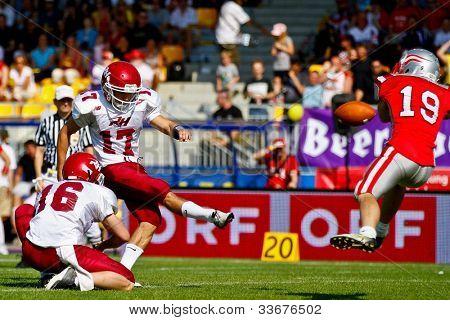 VIENNA, AUSTRIA - JUNE 5 Kicker Nick Schneider (#17 Rose Hulman) kicks a PAT on June 5, 2011 in Vienna, Austria. Rose Hulman College beats Team Austria 35:34 in overtime.