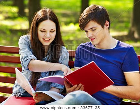 Group student with notebook summer outdoor.