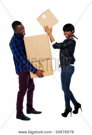 Smiling Couple Moving Cardboard Boxes