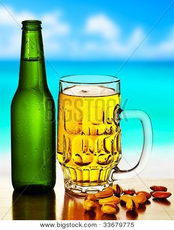 Cold beer on the beach, refreshing alcoholic drink with nuts mix, food and beverage still life, outdoor cafe,  summer leisure, vacation travel and fun concept
