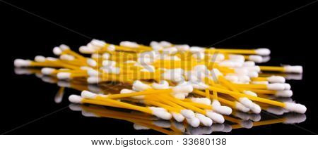 Cotton ear sticks isolated on black