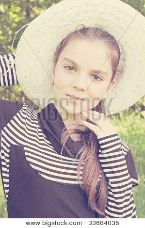 Senhora de chapéu