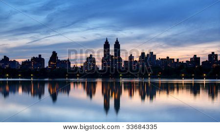 Skyline of buildings along Central Park West viewed from above Jackie Kennedy Onassis Reservoir in New York City.