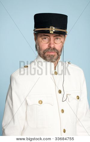 Man in the form of a naval officer in the pince-nez.