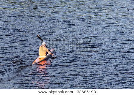 Man kayaking in the lake.