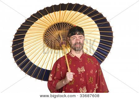European in the traditional Chinese dress holding an umbrella. Umbrella is made of bamboo and paper
