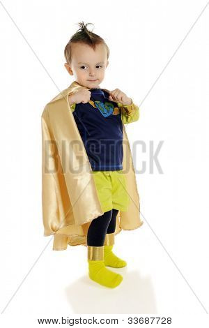 An adorable preschool superhero flexing his muscles under his cape.  On a white background.