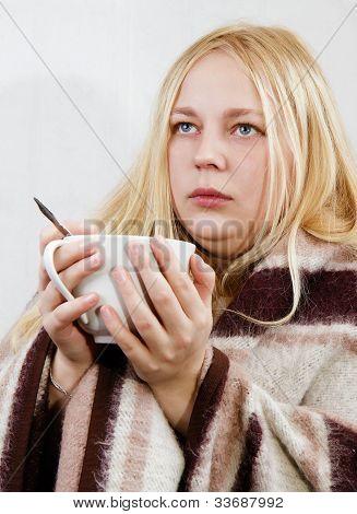 Mädchen mit einer Tasse
