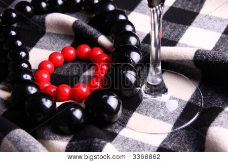 Necklaces On Checkerboard Pattern