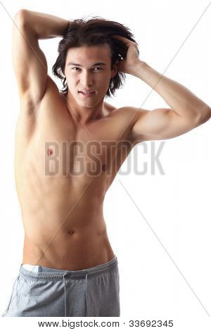 Image of shirtless man posing in front of camera