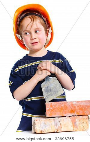 Boy in hard hat with brick