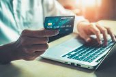 Young Man Use Credit Card For Online Shopping poster