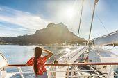 Bora bora island luxury cruise ship travel tourist woman watching sunset on balcony deck of Europe m poster