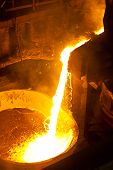 foto of blast-furnace  - Hot steel is poured into another pan - JPG