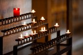 Prayer Candles Lit Inside A Church As A Votive Offering In An Act Or Prayer poster