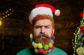 Christmas Decoration. Decorated Beard. Bearded Man With Decorated Beard. Christmas Holidays. Serious poster