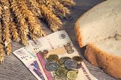 A Loaf Of Bread And Ears Of Ripe Wheat Lie On A Wooden Table Next To Russian Rubles. Bread And Wheat poster