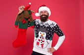 Fun Toy Present. Bearded Man Hold Christmas Present. Happy Hipster Got Present From Santa. Christmas poster