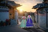 Two Korean Women Wear Hanbok Koreas Tradition Dress To Visit Bukchon Hanok Village In Seoul,  South poster