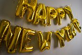 Celebrating The New Year. Gold Foil Balloons On A Gray Background. Foil Balls poster