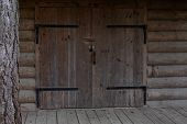 Old Wooden Gate Of A Rustic Barn, Rural Building For Cattle, Stable, Warehouse. Wooden Gate With Met poster